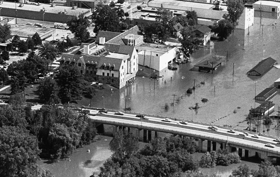 An aerial photo of a bridge over flood waters.