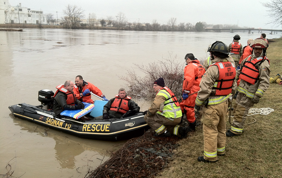 The Saginaw City Fire Department Rescue team on a boat.