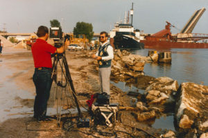 A news crew casting on the stuck freighter at the Independence Bridge